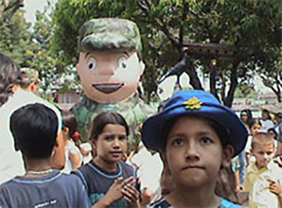 <p>Costumed soldiers try to win hearts and minds, El Paujil, Caquetá, 2004. Photo: Colombian Army</p>