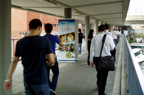 <p>Charity face-to-face campaigners engage commuters in the Hung Hom district of Hong Kong. Photo by Eric Fichtl</p>