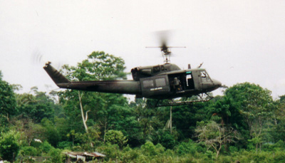 <p>A U.S.-supplied Colombian Army Huey helicopter in southern Colombia. Photo by Garry Leech</p>