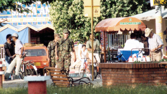<p>Civilians and soldiers mix in an Araucan town. Photo by Eric Fichtl</p>