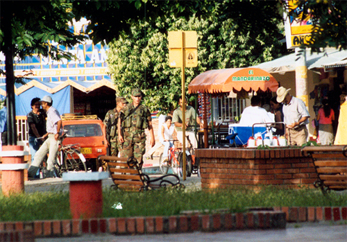 Two soldiers patrol Tame's central plaza. Photo: Eric Fichtl