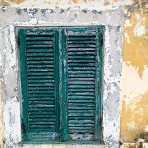<p>Weathered shutters and walls at Forte São Sebastião, São Tomé.</p>