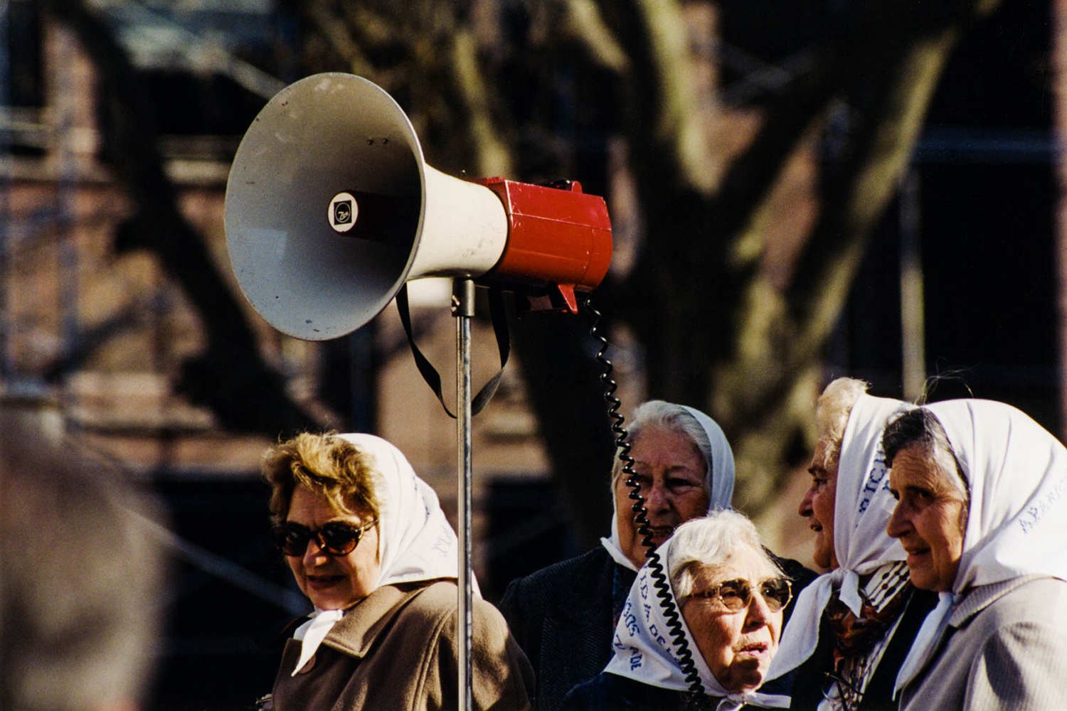 <p>Some of the Madres de la Plaza de Mayo prepare to air their calls for justice directly at the presidential palace in Buenos Aires. Their intense expressions match the determination they have shown in their decades-long struggle for accountability.</p>