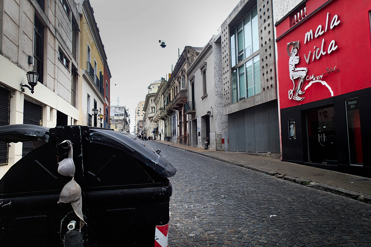 <p>A street in San Telmo wakes up with a bit of a hangover.</p>