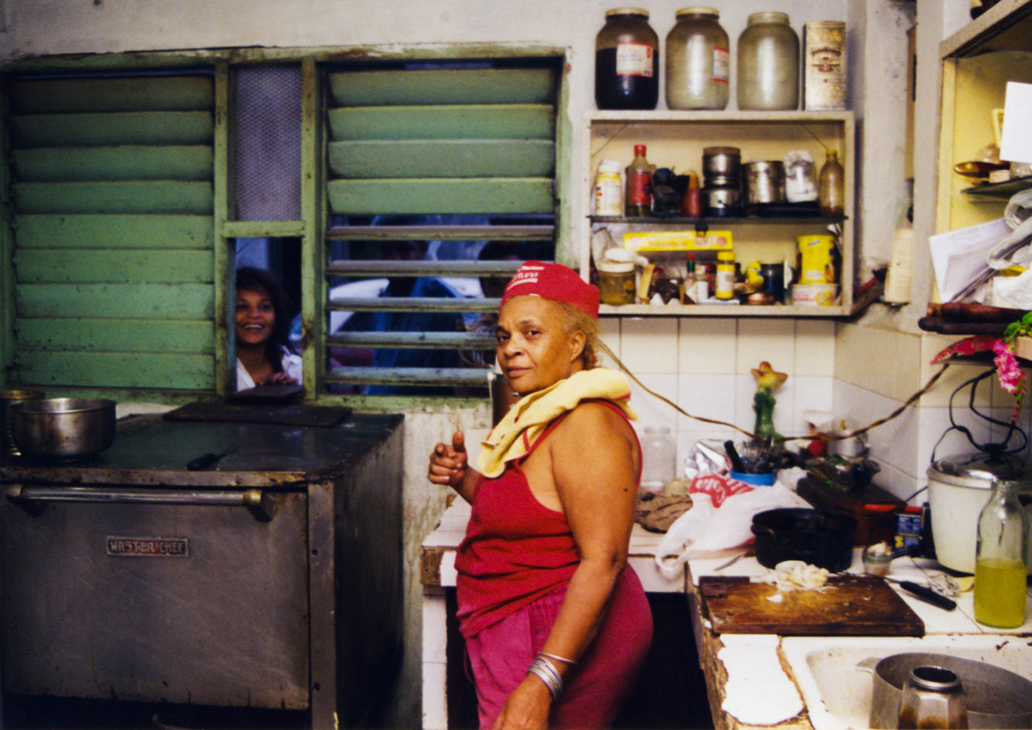 <p>Zoila stands in the middle of her kitchen, which doubles as a bakery in central Havana.<br /></p>