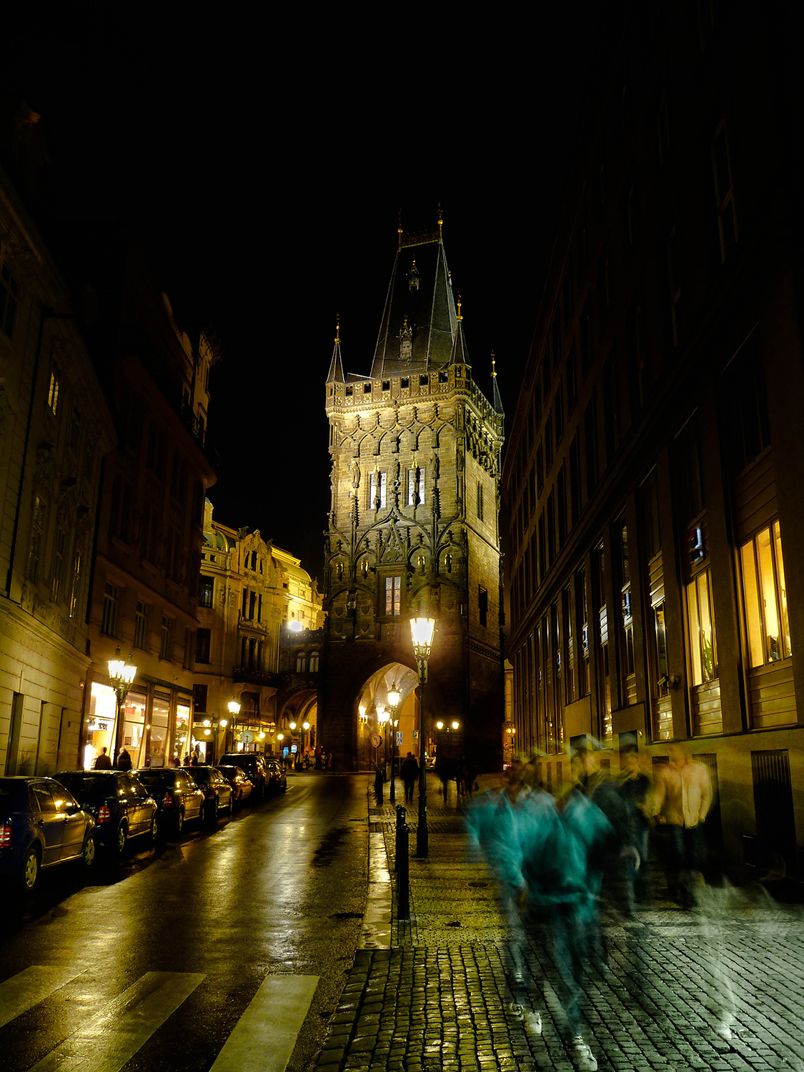 <p>A night scene in Prague's historic centre. The tower is the Prašná brána, or Powder Tower, a 15th Century gate in the city walls.</p>