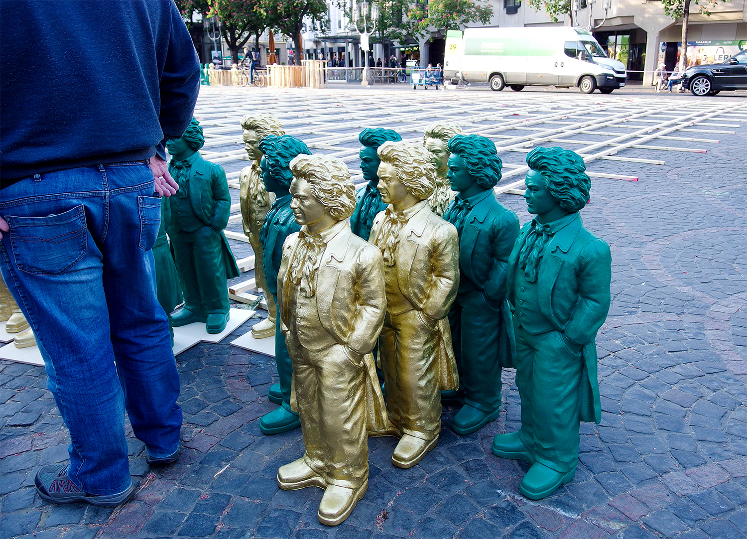 <p>A gang of miniature Beethovens wait to be placed in formation by a worker. Part of Bonn's commemoration of the 250th anniversary of its famous son's birth, the Beethoven statues were later put up for 'adoption'. I like mine very much. </p>