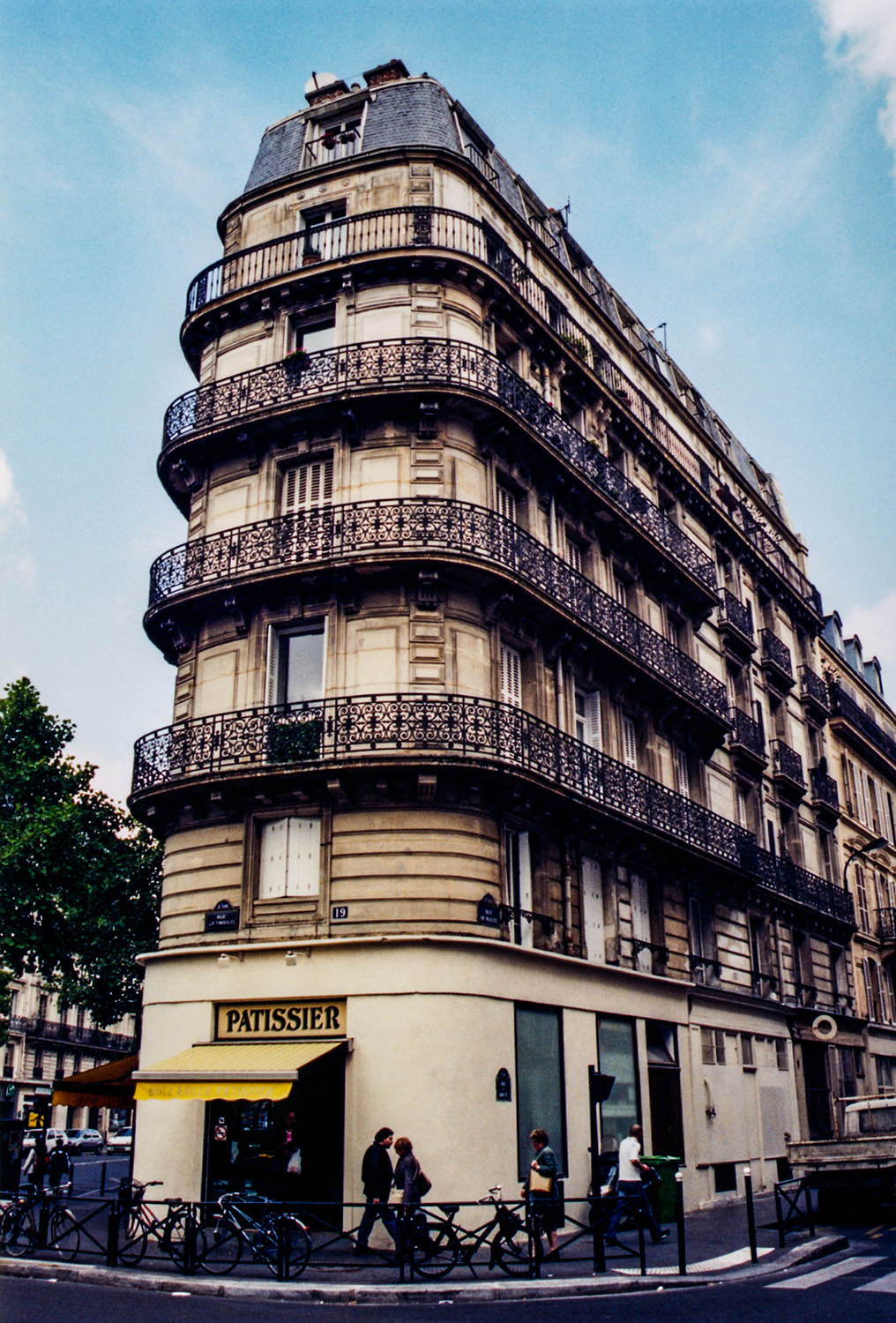 <p>A patisserie takes pride of place on a Parisian corner.</p>