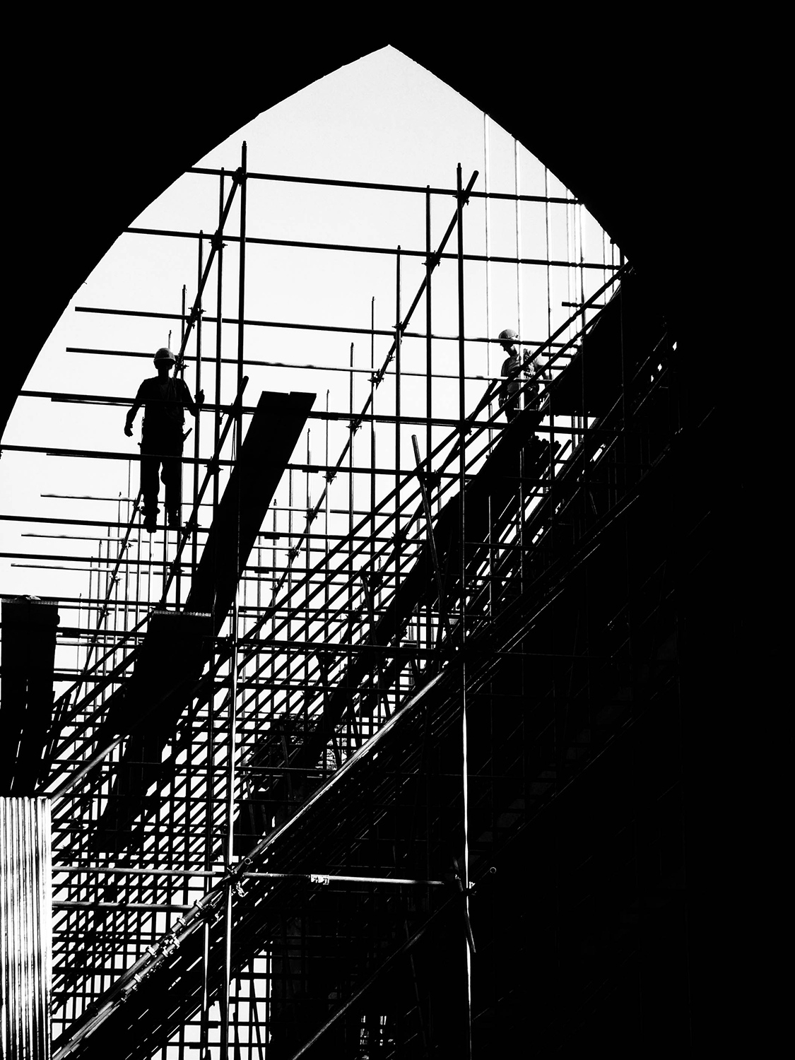 <p>Builders on a scaffold working on restorations in the Rock of Cashel complex.</p>