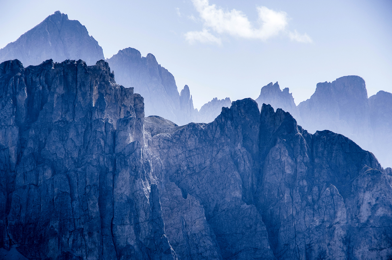 <p>A telephoto shot of the face of some of the lesser Dolomite peaks, with the Odle group in the distance.</p>
