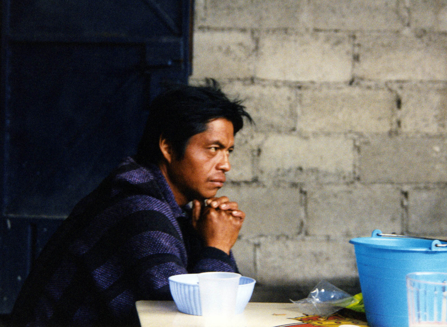 <p>A man thinks while drinking pulque, a traditional Mesoamerican indigenous drink made from the maguey plant.</p>
