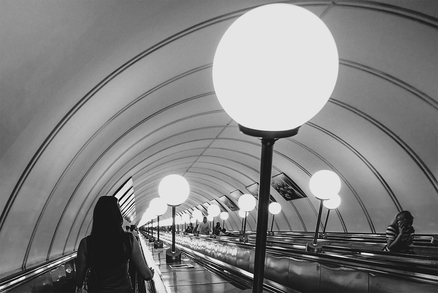 <p>Passengers descending into and ascending out of one of Moscow's very deep metro stations.</p>