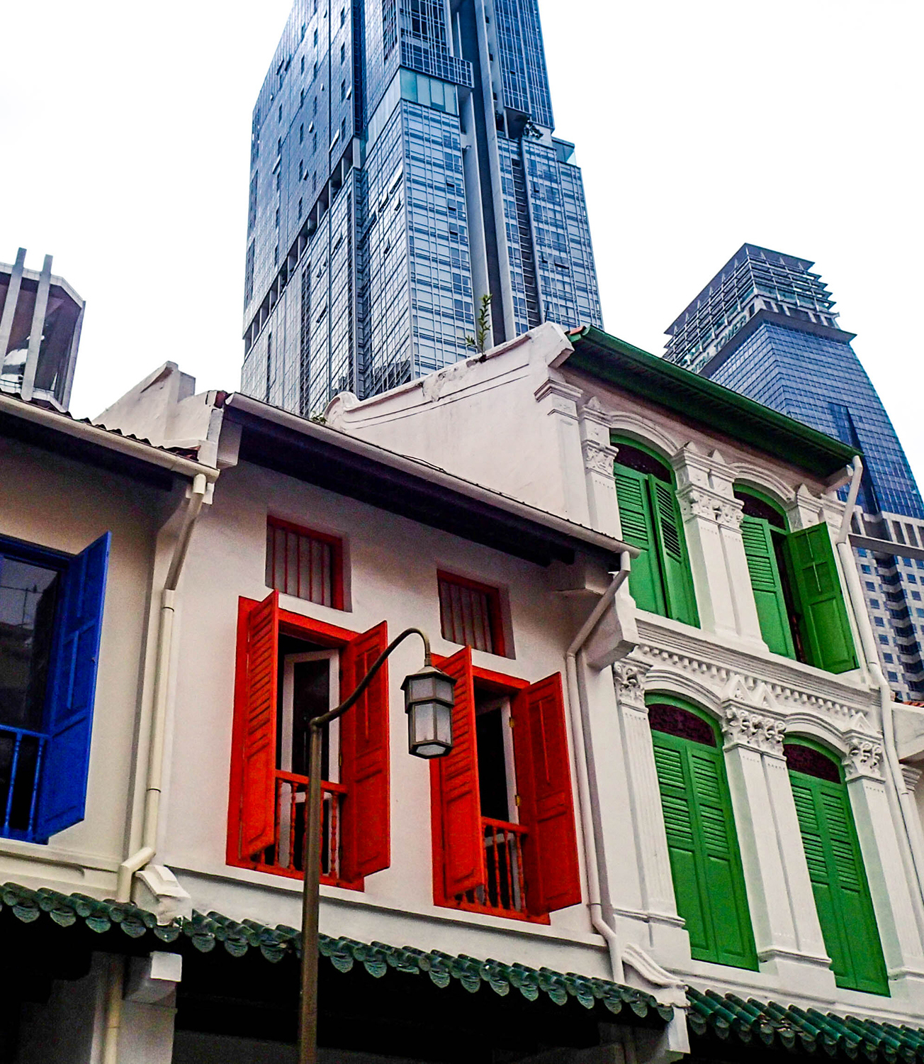 <p>A pleasing clash of styles at the transition between Chinatown and the Central business district. Amoy Street is full of Singapore's characteristic shophouses, which typically combine commercial activities (shops, restaurants) on the ground floor with residences above.</p>