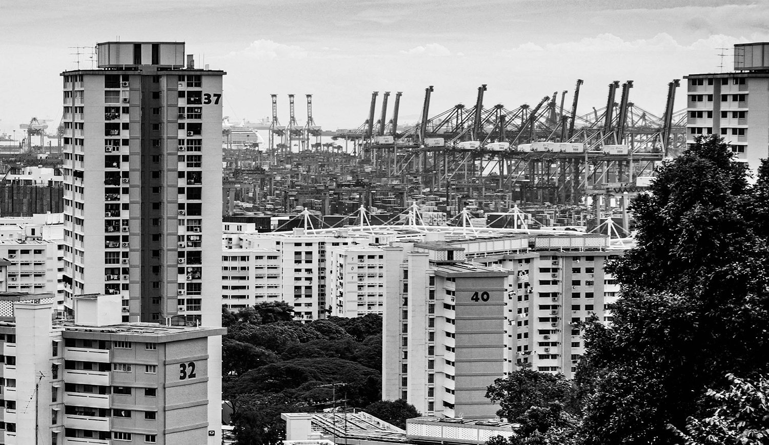 <p>A view over Singapore's public housing blocks and cranes at the city-state's immense container terminals.<br /></p>