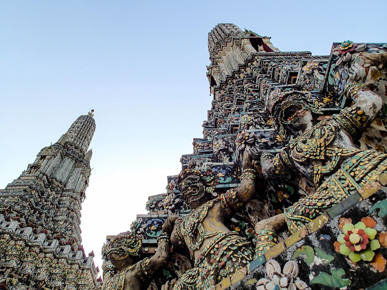 <p>A detail of figures at the Temple of the Dawn, or Wat Arun Ratchawararam Ratchaworawihan, in Bangkok.</p>