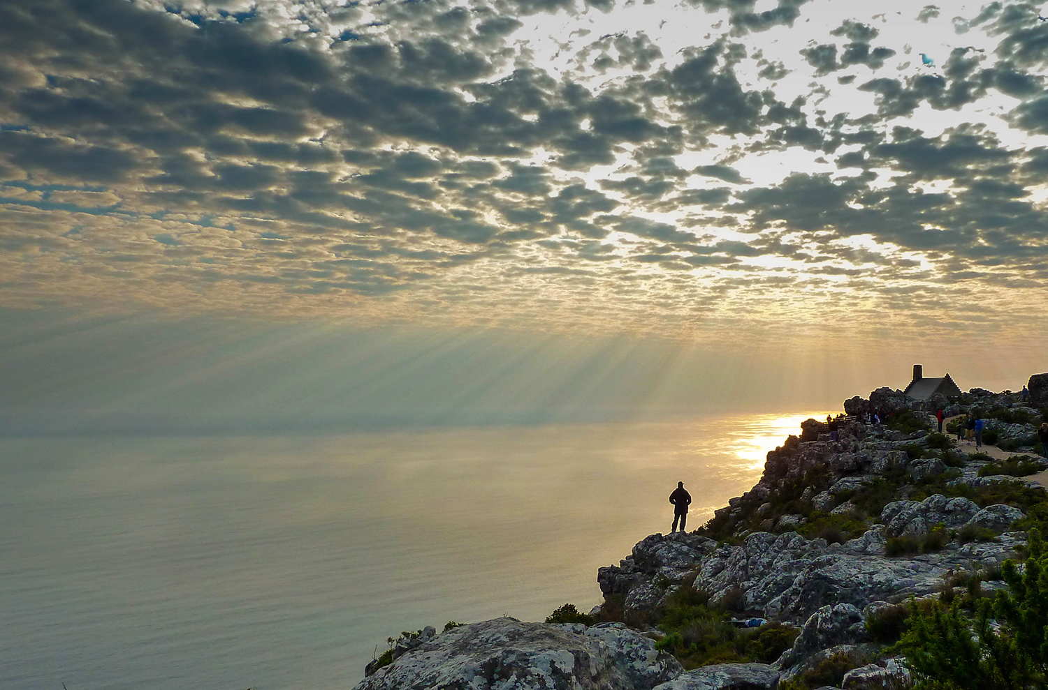 <p>A person enjoys the spectacular views over Cape Town and the ocean from atop Table Mountain. The sky was amazing that day.</p>